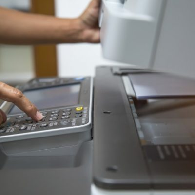 closeup-hand-press-button-using-photocopier-xerox-machine_101448-1541